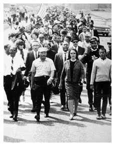 Dr. Martin Luther King and wife march